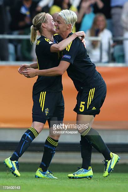 Nilla Fischer of Sweden celebrates the first goal with Marie Hammarstroem during the UEFA Women's EURO 2013 Group A match between Finland and Sweden...