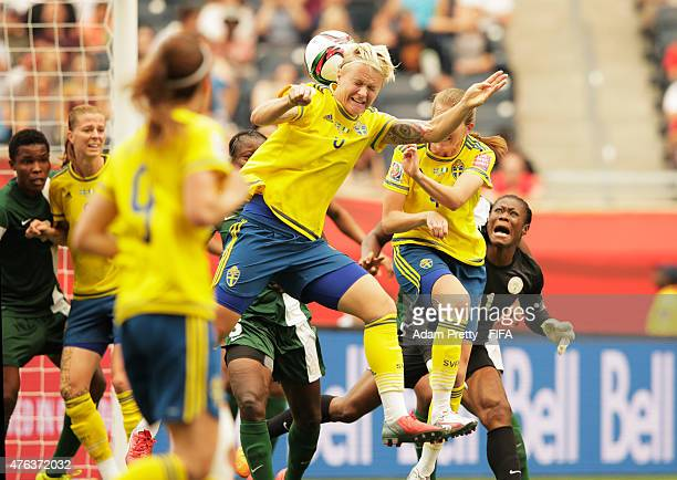 Nilla Fischer of Sweden heads the ball and scores the first goal during the FIFA Women's World Cup Canada 2015 Group D match between Sweden and...