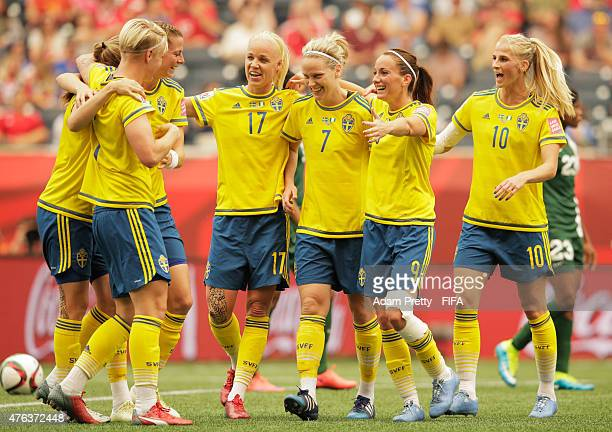 Nilla Fischer of Sweden is congratlated by Kosovare Asllani of Sweden and team mates after scoring the second goal during the FIFA Women's World Cup...