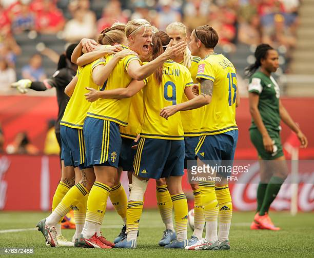 Nilla Fischer of Sweden is congratulated after scoring the second goal during the FIFA Women's World Cup Canada 2015 Group D match between Sweden and...