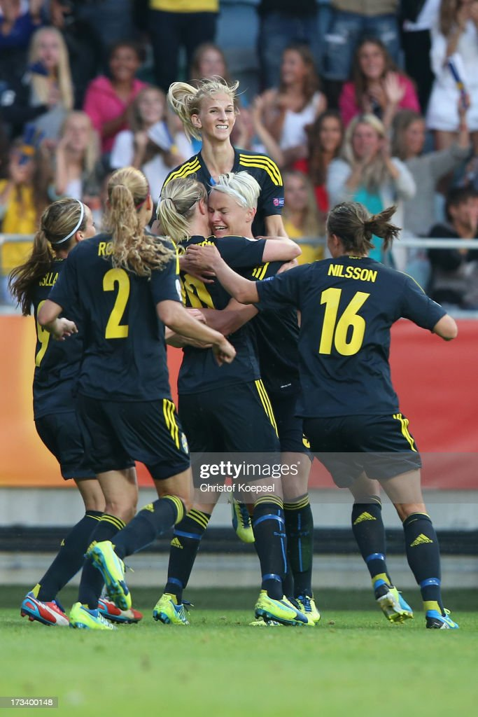 <a gi-track='captionPersonalityLinkClicked' href=/galleries/search?phrase=Nilla+Fischer&family=editorial&specificpeople=2398003 ng-click='$event.stopPropagation()'>Nilla Fischer</a> of Sweden (2nd R) of Sweden celebrates the first goal with her team mates during the UEFA Women's EURO 2013 Group A match between Finland and Sweden at Gamla Ullevi Stadium on July 13, 2013 in Gothenburg, Sweden.