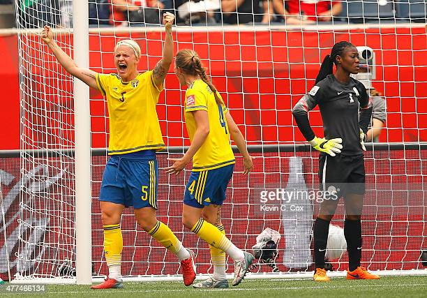 Nilla Fischer of Sweden reacts after scoring the second goal against goalkeeper Precious Dede of Nigeria with Emma Berglund during the FIFA Women's...