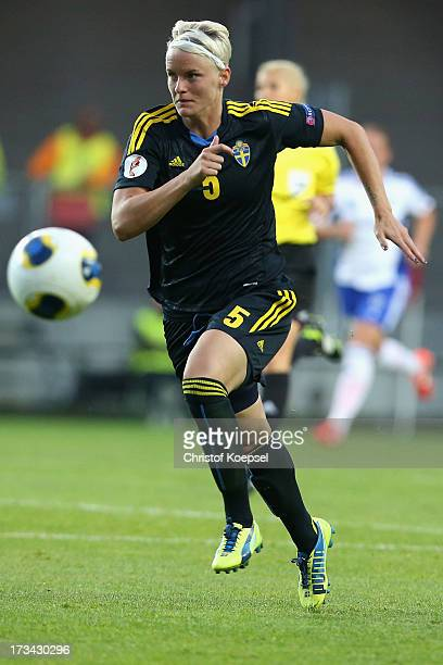 Nilla Fischer of Sweden runs with the ball during the UEFA Women's EURO 2013 Group A match between Finland and Sweden at Gamla Ullevi Stadium on July...