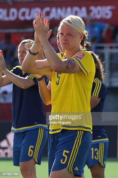 Nilla Fischer of Sweden salutes the crowd after a loss in the FIFA Women's World Cup Canada 2015 round of 16 match between Germany and Sweden at...