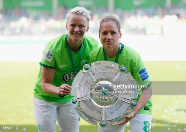 Nilla Fischer of VfL Wolfsburg and Babett Peter of VfL Wolfsburg pose with the Championship trophy in celebration of the German Championship title...