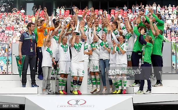 Nilla Fischer of Wolfsburg and team celebrate the winning of the cup after the women's cup final between SC Sand and VFL Wolfsburg at...