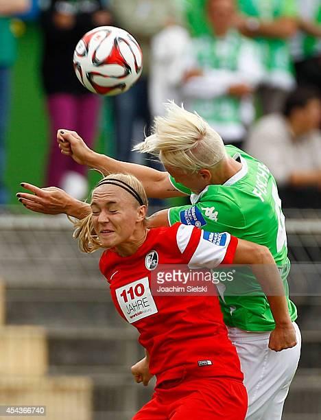 Nilla Fischer of Wolfsburg challenges Sarah Puntigam of Freiburg during the Allianz Women's Bundesliga match between VfL Wolfsburg and SC Freiburg on...