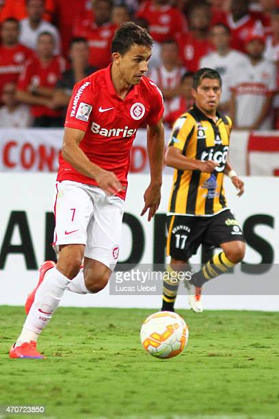 Nilmar of Internacional battles for the ball against Nelvin Soliz of The Strongest during match between Internacional and The Strongest as part of...