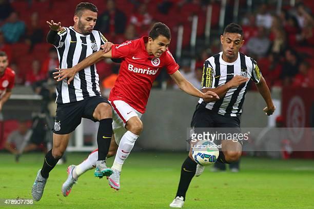 Nilmar of Internacional battles for the ball against Thiago Maia of Santos during the match between Internacional and Santos as part of Brasileirao...