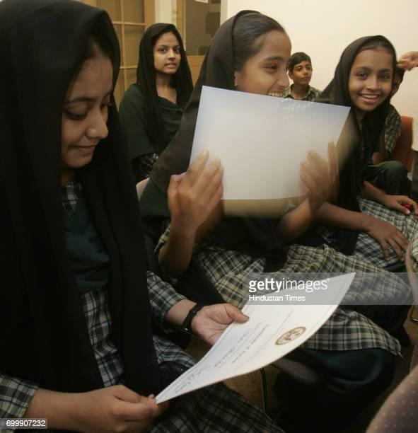 Nilofer and Afroz from Jafri English High School Govandi shares light moments after they receive certificate for English Access Microscholarship...