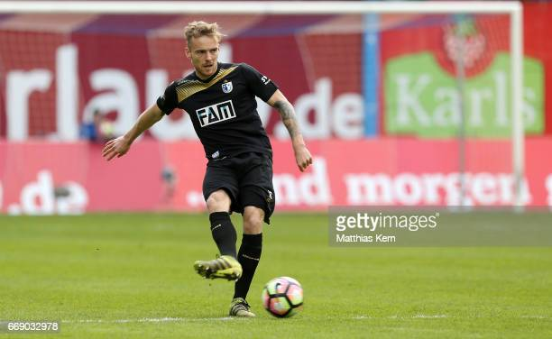 Nils Butzen of Magdeburg runs with the ball during the third league match between FC Hansa Rostock and 1FC Magdeburg at Ostseestadion on April 15...