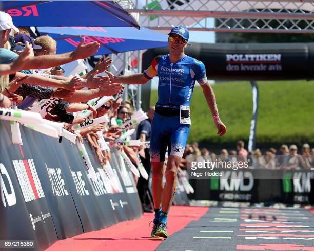 Nils Frommhold of Germany reacts after finishing third at KMD IRONMAN 703 European Championship Elsinore on June 18 2017 in Helsingor Denmark
