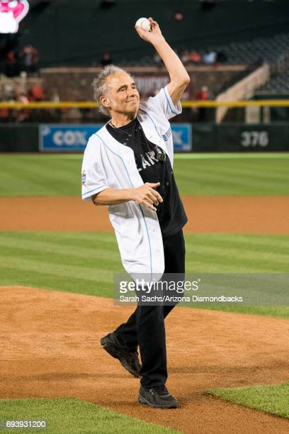 Nils Lofgren member of the band E Street Band throws out the ceremonial first pitch prior to an Arizona Diamondbacks game against the San Diego...