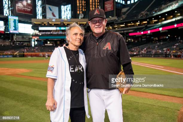 Nils Lofgren member of the band E Street Band throws out the ceremonial first pitch to bench coach Ron Gardenhire of the Arizona Diamondbacks prior...