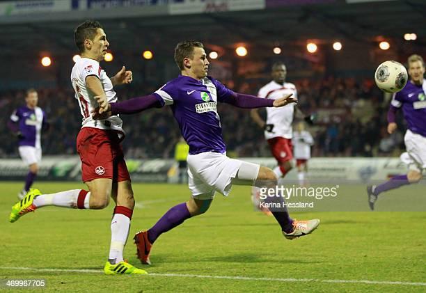 Nils Miatke of Aue is challenged by Karim Matmour of Kaiserslautern during the Second Bundesliga match Erzgebirge Aue v 1 FC Kaiserslautern at...