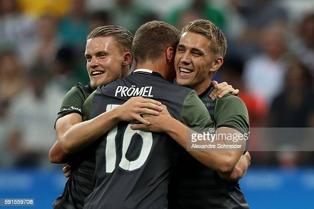 Nils Petersen of Germany celebrates scoring a goal with team mates Philipp Max and Grischa Proemel of Germany during the Men's Semifinal Football...
