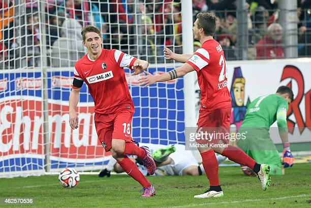 Nils Petersen and Maximilian Philipp of Freiburg celebrate the 3rd goal of Petersen that made it 41 during the Bundesliga match between SC Freiburg...