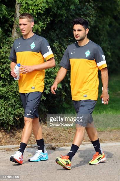 Nils Petersen and Mehmet Ekici walk to the training ground at Weser Stadium on July 5 2012 in Bremen Germany