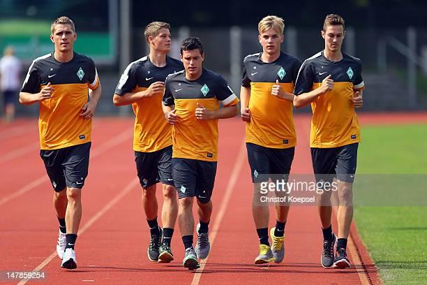 Nils Petersen Johannes Wurtz Zlatko Junuzovic Cimo Roecker and Francois Affolter run during blood testing of Werder Bremen at the training ground at...