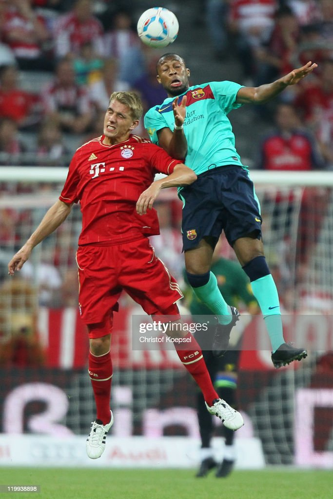 Nils Petersen of Bayern and <a gi-track='captionPersonalityLinkClicked' href=/galleries/search?phrase=Seydou+Keita&family=editorial&specificpeople=709847 ng-click='$event.stopPropagation()'>Seydou Keita</a> of Barcelona go up for a header during the Audi Cup final match between FC Bayern Muenchen and FC Barcelona at Allianz Arena on July 27, 2011 in Munich, Germany.