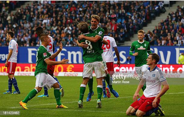 Nils Petersen of Bremen celebrate with team mate Clemsn Fritz after he scores his team's opening goal during the Bundesliga match between Hamburger...