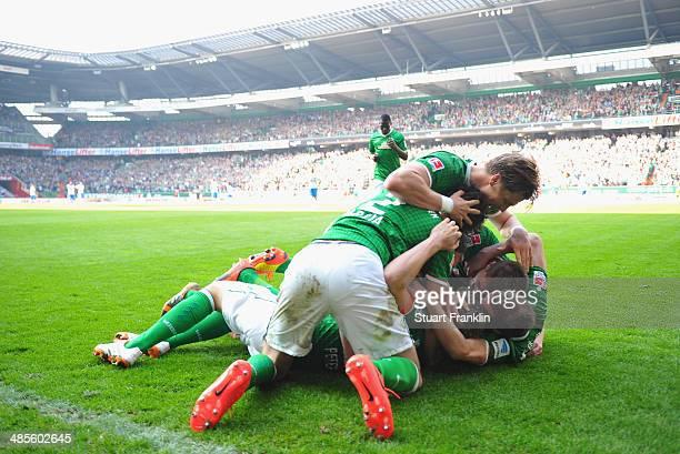 Nils Petersen of Bremen celebrates scoring his goal with teamates during the Bundesliga match between Werder Bremen and 1899 Hoffenheim at...