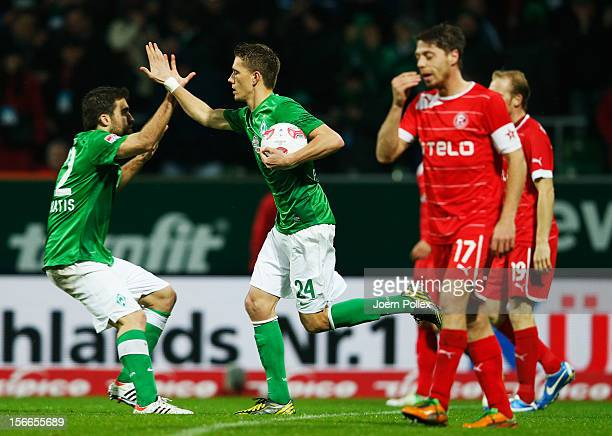 Nils Petersen of Bremen celebrates with his team mate Sokratis Papastathopoulos after scoring his team's first goal during the Bundesliga match...