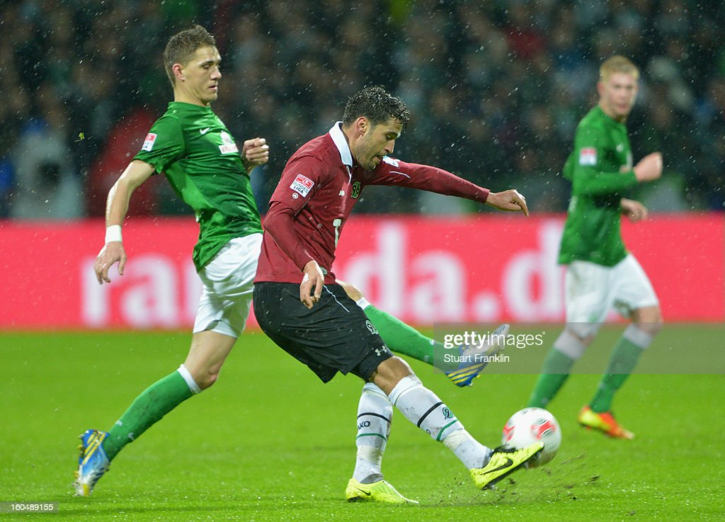 Nils Petersen of Bremen challenges for the ball with Manuel Schmiedebach of Hannover during the Bundesliga match between SV Werder Bremen and Hannover 96 at Weser Stadium on February 1, 2013 in Bremen, Germany.