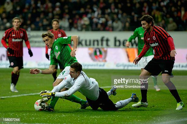 Nils Petersen of Bremen challenges goalkeeper Kevin Trapp of Frankfurt during the Bundesliga match between Eintracht Frankfurt and SV Werder Bremen...