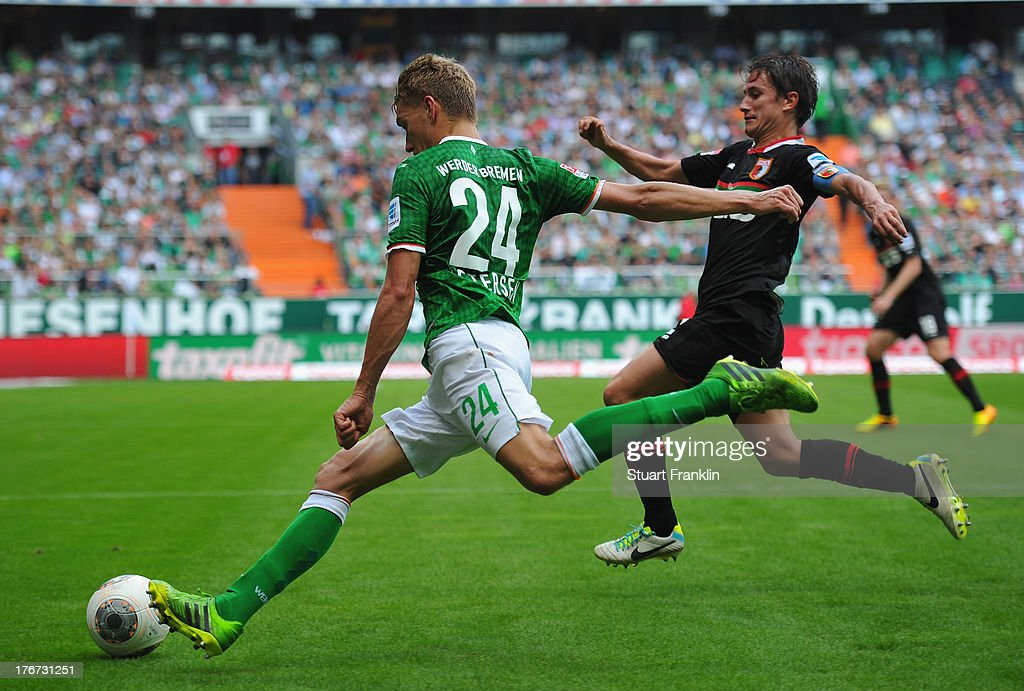 <a gi-track='captionPersonalityLinkClicked' href=/galleries/search?phrase=Nils+Petersen&family=editorial&specificpeople=4400792 ng-click='$event.stopPropagation()'>Nils Petersen</a> of Bremen is challenged by Paul Verhaegh of Augsburg during the Bundesliga match between Werder Bremen and FC Augsburg at Weserstadion on August 17, 2013 in Bremen, Germany.