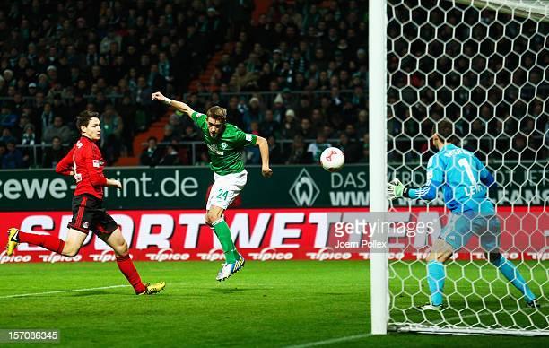 Nils Petersen of Bremen scores his team's first goal during the Bundesliga match between Werder Bremen and Bayer 04 Leverkusen at Weser Stadium on...
