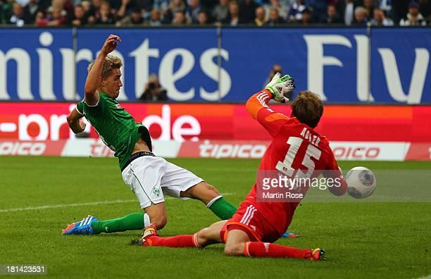 Nils Petersen of Bremen scores his team's opening goal during the Bundesliga match between Hamburger SV and Werder Bremen at Imtech Arena on...
