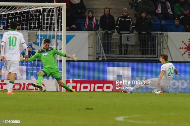 Nils Petersen of Bremen scores his team's third goal against goalkeeper Koen Casteels of Hoffenheim during the Bundesliga match between 1899...