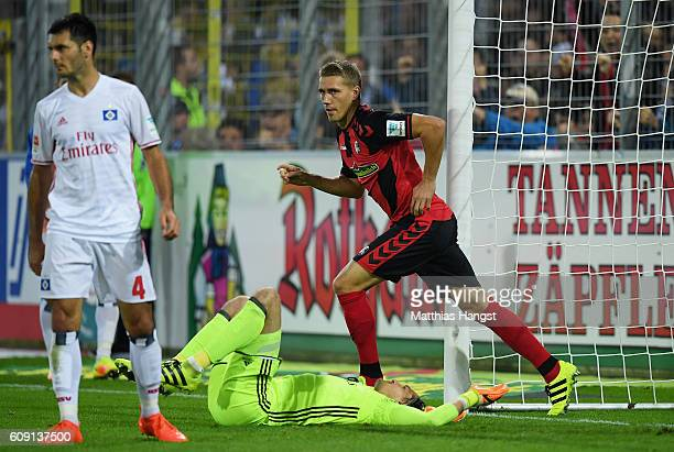 Nils Petersen of Freiburg celebrates after scoring his team's first goal against goalkeeper Rene Adler of Hamburg during the Bundesliga match between...
