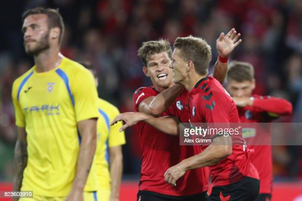 Nils Petersen of Freiburg celebrates his team's first goal with team mate Florian Niederlechner during the UEFA Europa League Third Qualifying Round...
