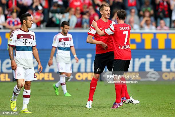 Nils Petersen of Freiburg celebrates victory with his team mate Vladimir Darida after the Bundesliga match between Sport Club Freiburg and FC Bayern...