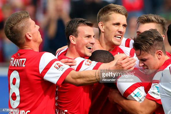 Nils Petersen of Freiburg celebrates victory with his team mates after scoring the winning goal during the Bundesliga match between Sport Club...
