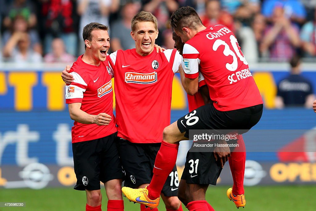 Nils Petersen (C) of Freiburg celebrates victory with his team mates after the Bundesliga match between Sport Club Freiburg and FC Bayern Muenchen at Schwarzwald-Stadion on May 16, 2015 in Freiburg im Breisgau, Germany.