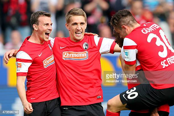 Nils Petersen of Freiburg celebrates victory with his team mates after the Bundesliga match between Sport Club Freiburg and FC Bayern Muenchen at...