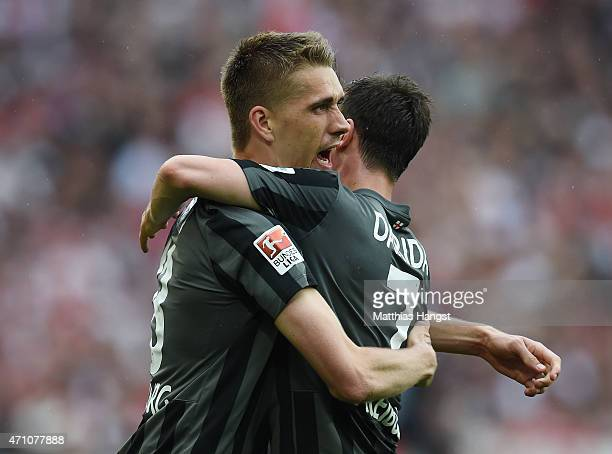 Nils Petersen of Freiburg celebrates with his teammates after scoring his team's second goal during the Bundesliga match between VfB Stuttgart and SC...