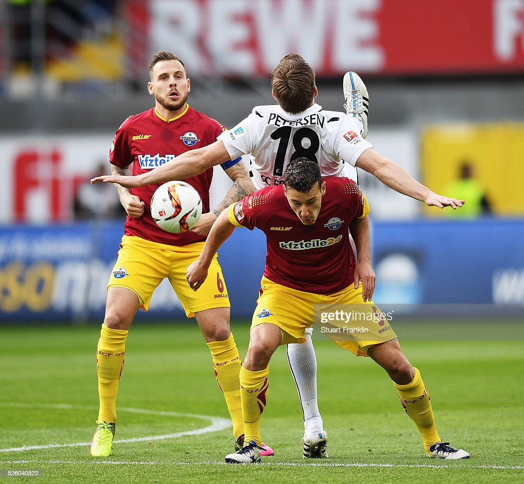<a gi-track='captionPersonalityLinkClicked' href=/galleries/search?phrase=Nils+Petersen&family=editorial&specificpeople=4400792 ng-click='$event.stopPropagation()'>Nils Petersen</a> of Freiburg is challenged by Dominik Wydra of Paderborn during the second Bundesliga match between SC Paderborn and SC Freiburg at the Benteler Arena on April 29, 2016 in Paderborn, North Rhine-Westphalia.