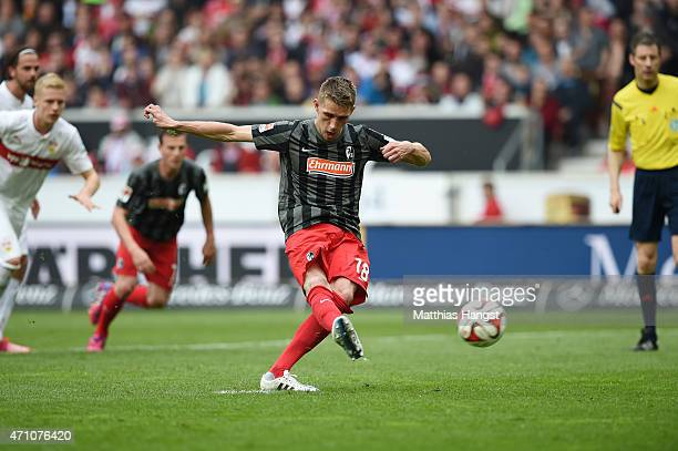 Nils Petersen of Freiburg scores his team's first goal by a penalty kick during the Bundesliga match between VfB Stuttgart and SC Freiburg at...