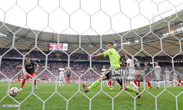 Nils Petersen of Freiburg scores his team's second goal past goalkeeper Sven Ulreich of Stuttgart during the Bundesliga match between VfB Stuttgart...