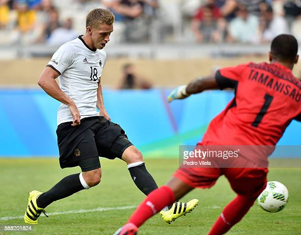Nils Petersen of Germany scores a goal against goalkeeper Simione Tamanisau of Fiji during the Men's First Round Football Group C match between...