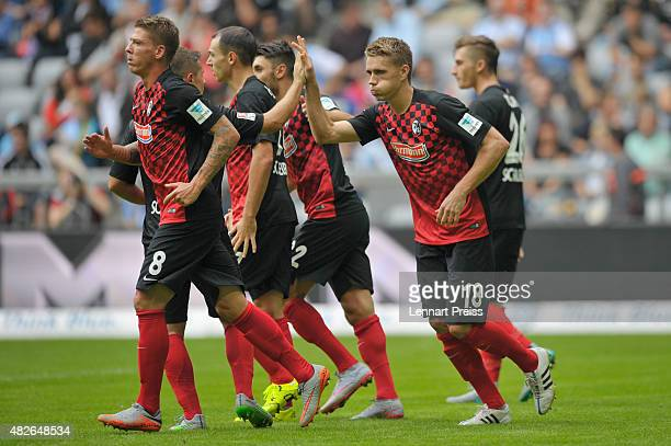 Nils Petersen of SC Freiburg and his teammates celebrate the opening goal during the 2 Bundesliga match between TSV 1860 Muenchen and SC Freiburg at...