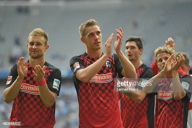 Nils Petersen of SC Freiburg and his teammates celebrate winning the 2 Bundesliga match between TSV 1860 Muenchen and SC Freiburg at Allianz Arena on...