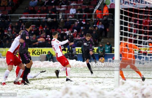 Nils Petersen of SC Freiburg shoots and scores his side's first goal during the Bundesliga match between 1 FC Koeln and SportClub Freiburg at...