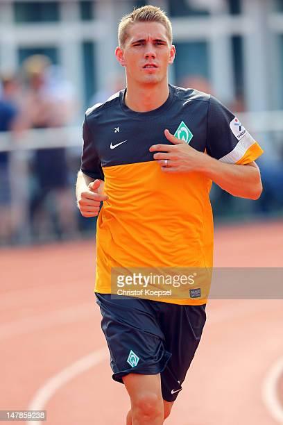 Nils Petersen runs during blood testing of Werder Bremen at the training ground at Weser Stadium on July 5 2012 in Bremen Germany