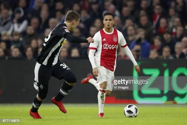 Nils Rutten of Borussia Monchengladbach Justin Kluivert of Ajax during the international friendly match between Ajax Amsterdam and Borussia...