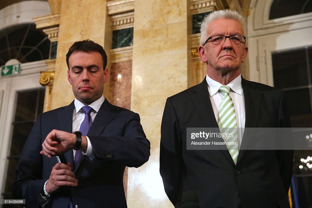 Nils Schmid (L), top candidate of the German Social Democratic Party (SPD) and <a gi-track='captionPersonalityLinkClicked' href=/galleries/search?phrase=Winfried+Kretschmann&family=editorial&specificpeople=7227897 ng-click='$event.stopPropagation()'>Winfried Kretschmann</a>, incumbent governor of Baden-Wuerttemberg and member of the German Greens Party (Buendnis 90/Die Gruenen) looks on during a press conference on election night following initial voting results of Baden-Wuerttenberg state election at Neues Schloss Stuttgart on March 13, 2016 in Stuttgart, Germany. State elections taking place today in three German states: Rhineland-Palatinate, Saxony-Anhalt and Baden-Wuerttemberg, are a crucial test-case for German Chancellor and Chairwoman of the German Christian Democrats (CDU) Angela Merkel, who has come under increasing pressure over her liberal immigration policy towards migrants and refugees. The populist Alternative fuer Deutschland (Alternative for Germany, AfD), with campaign rhetoric aimed at Germans who are uneasy with so many newcomers, has solid polling numbers and will almost certainly win seats in all three state parliaments.